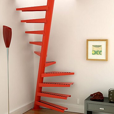 A space-saving staircase between a floor lamp, painting with wooden frame and a cabinet with a drawer.