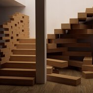 The staircase in the Jenga-style that EeStairs makes in front of an episode of Extreme Makeover: Home Edition.