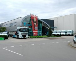 Exterior of the property of EeStairs Barneveld, with company truck and company buses.