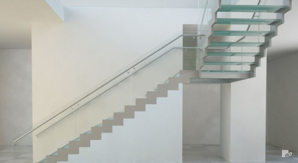 An open landing staircase with glass treads, on a natural stone floor in shopping centre the CORE in Calgary.