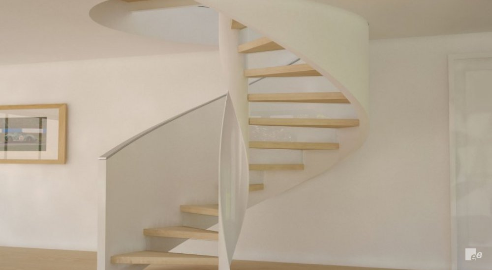 A spiral staircase with wooden treads on a laminate floor, in front of a white stucco wall with photo frame.