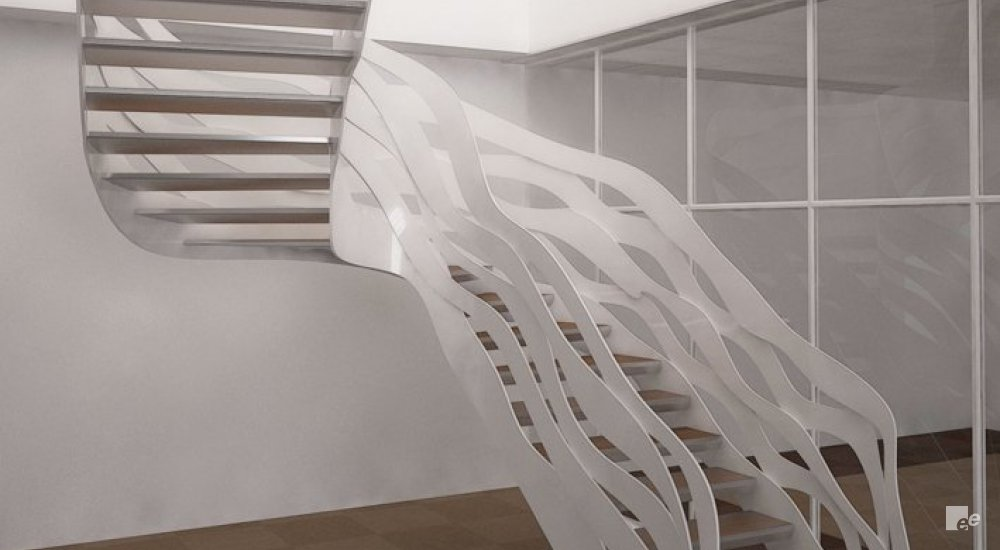 A staircase with a steel balustrade, in front of a white stucco wall, glass wall and carpet floor.
