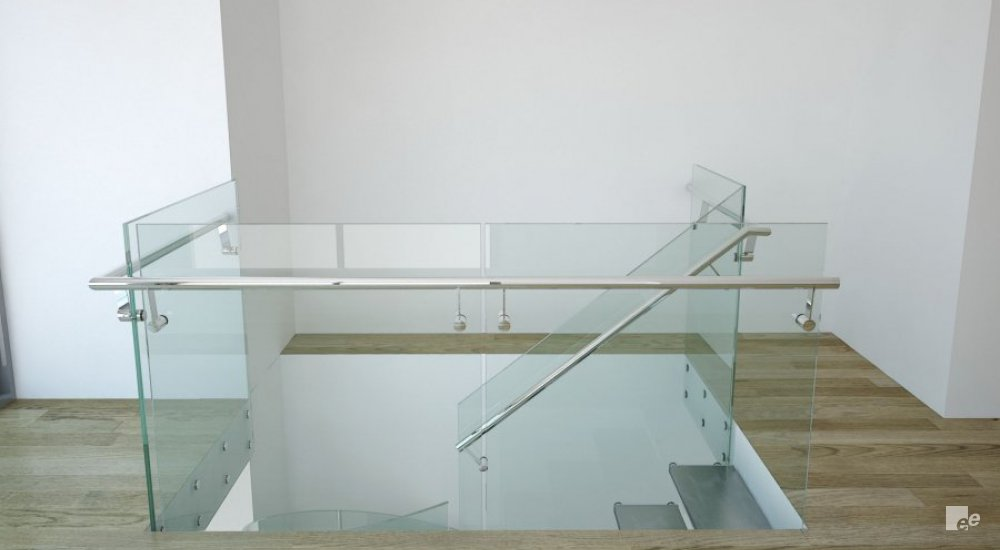A glass balustrade, laminate floor and a white stucco wall in an apartment in New York.