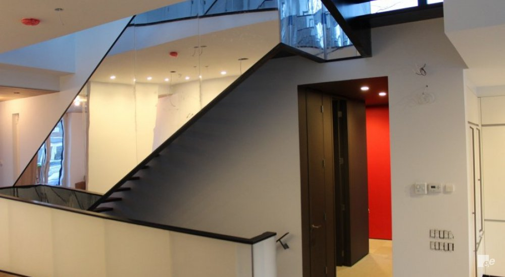 A balustrade with mirrors in the offices of Duffy and Associates in Toronto in Canada.