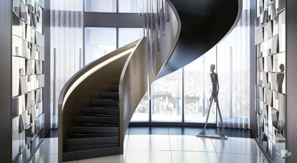 A winding staircase with Cohiba treads and steel balustrades, next to a statue of a hiker and in front of high windows.
