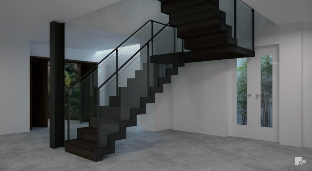 A landing staircase with dark oiled wooden treads in a living room with natural stone floor, a pillar and French doors.