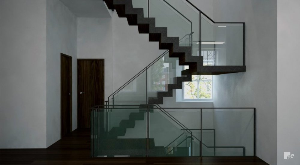 A landing staircase with glass balustrades on a landing with wooden doors and a white stucco wall.