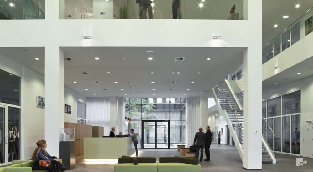 The entrance to the Mediahuis, with the reception, round ceiling lights and designer sofas.